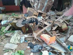 The suspect's home is badly damaged by the mob