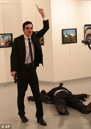 3b85da3000000578-4048844-turkey_s_anadolu_agency_said_the_gunman_pictured_has_been_neutra-a-7_1482167919297