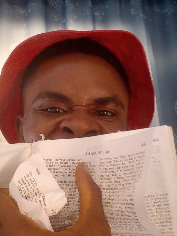 Man Tears Copy Of The Bible After A Catholic Priest Destroyed A Shrine In His Community In Anambra