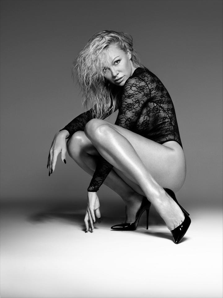 Pamela Anderson Posing For Bondage-Inspired Lingerie Photoshoot