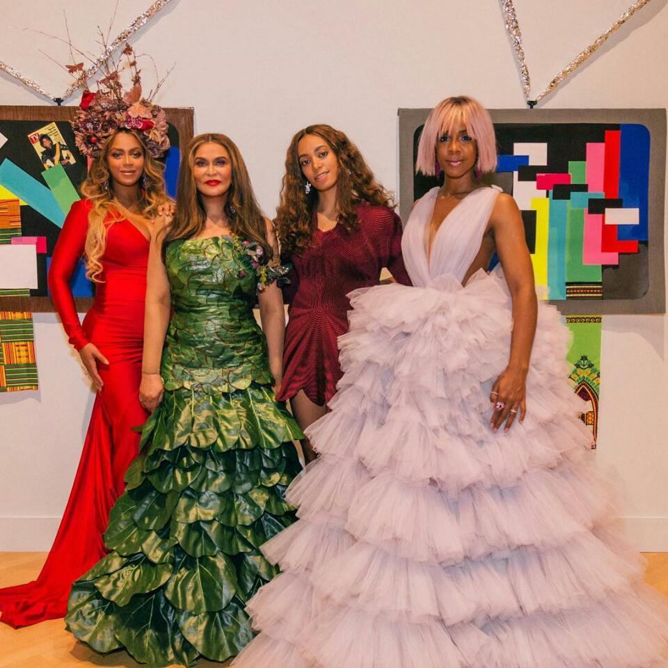 Beyonce Shows Off Family Photo While Rocking Red-Hot Gown And Headpiece