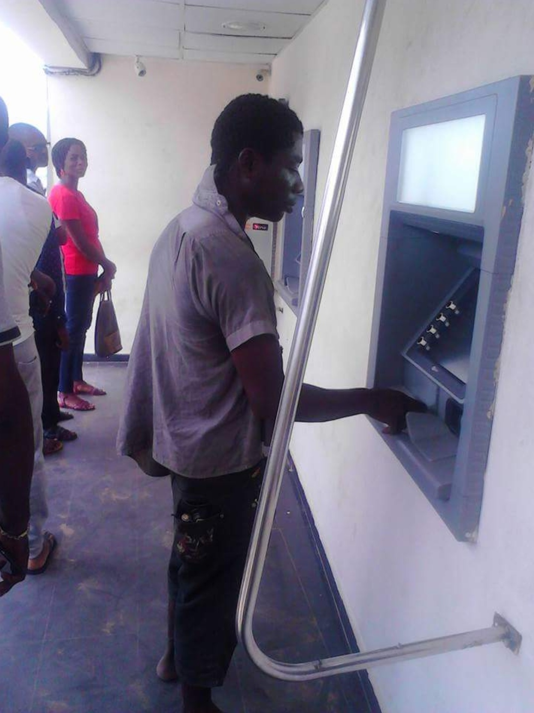 Mad Man Attempted Withdrawing At An ATM (1)