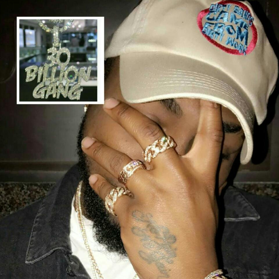 Davido Shows Off His New Diamond Encrusted 30 Billion Gang Necklace