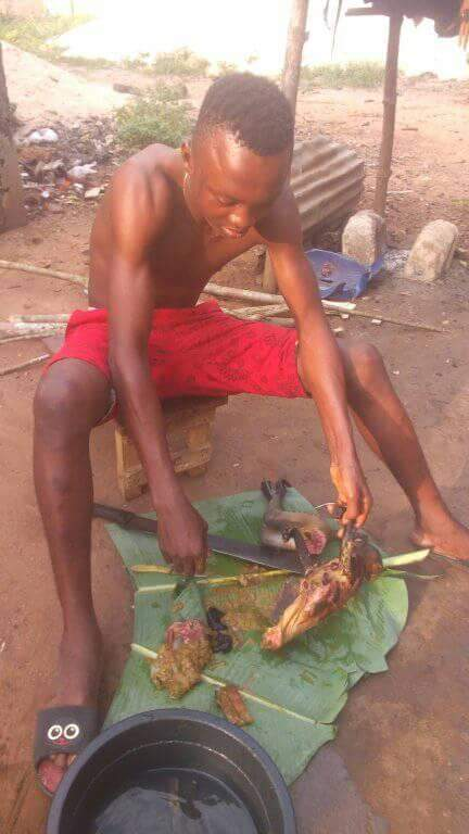 Nigerian Man Pictured Slaughtering Roasted Monkey He Just Killed In Rivers State (5)