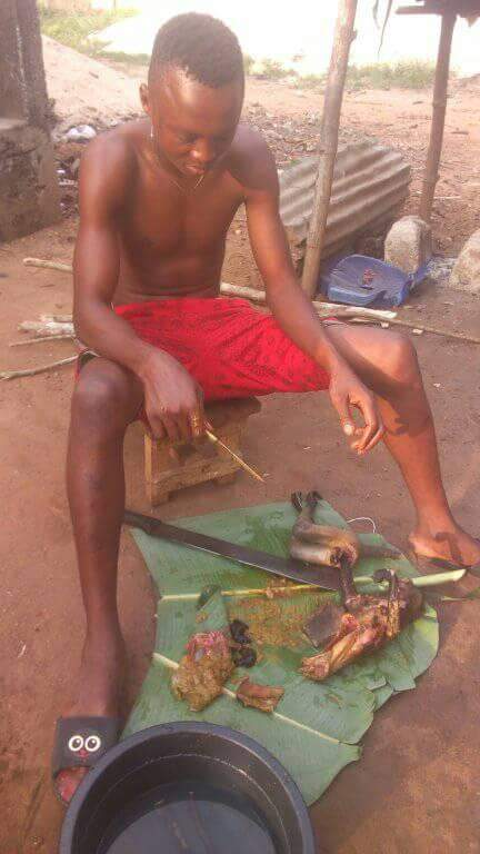Nigerian Man Pictured Slaughtering Roasted Monkey He Just Killed In Rivers State (7)