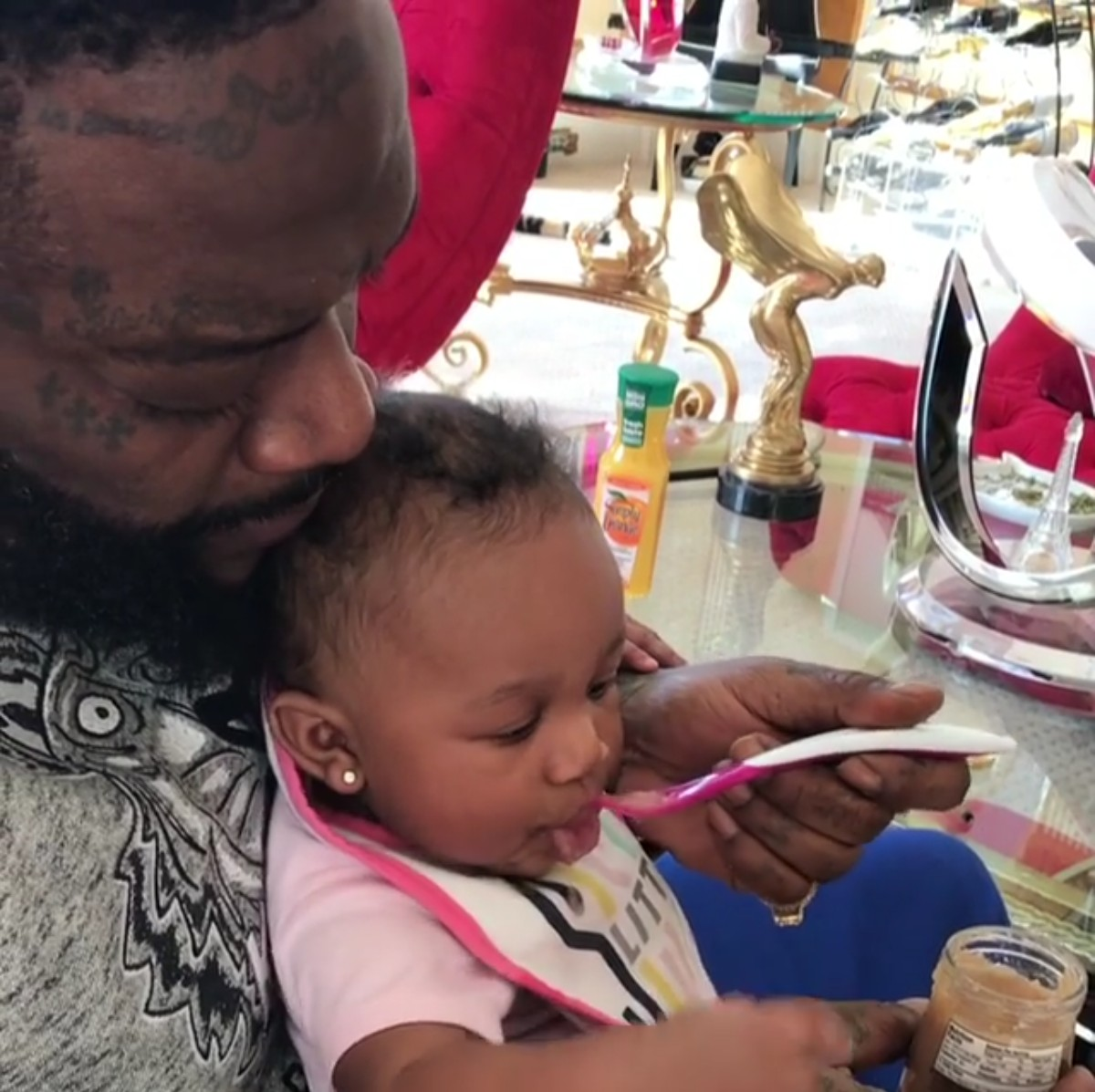 Rick Ross Daughter Hermes Eating From A Spoon For The First Time (3)
