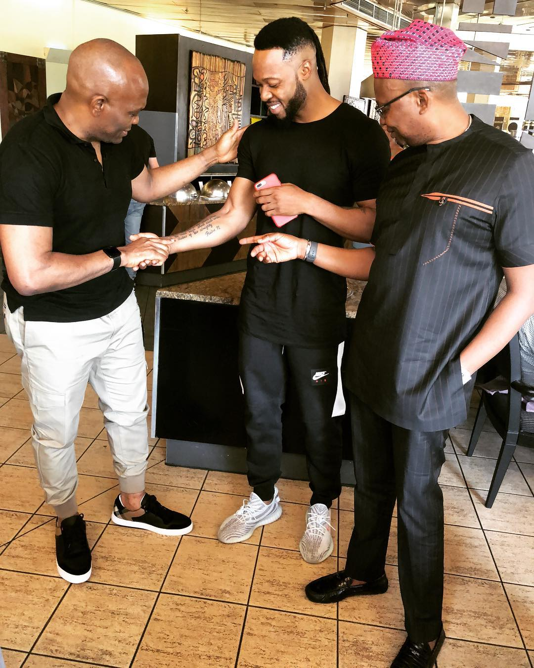 Tony Elumelu Pictured Checking Out Flavour's Tattoos (2)