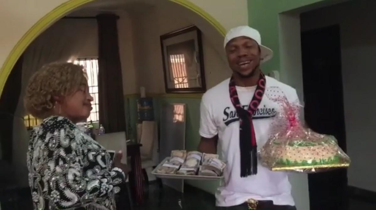 Charles Okocha Gifts His Mum Tray Full Of Cash (3)