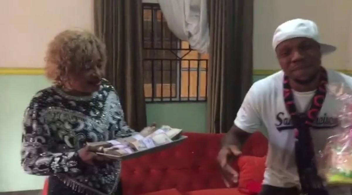 Charles Okocha Gifts His Mum Tray Full Of Cash (4)