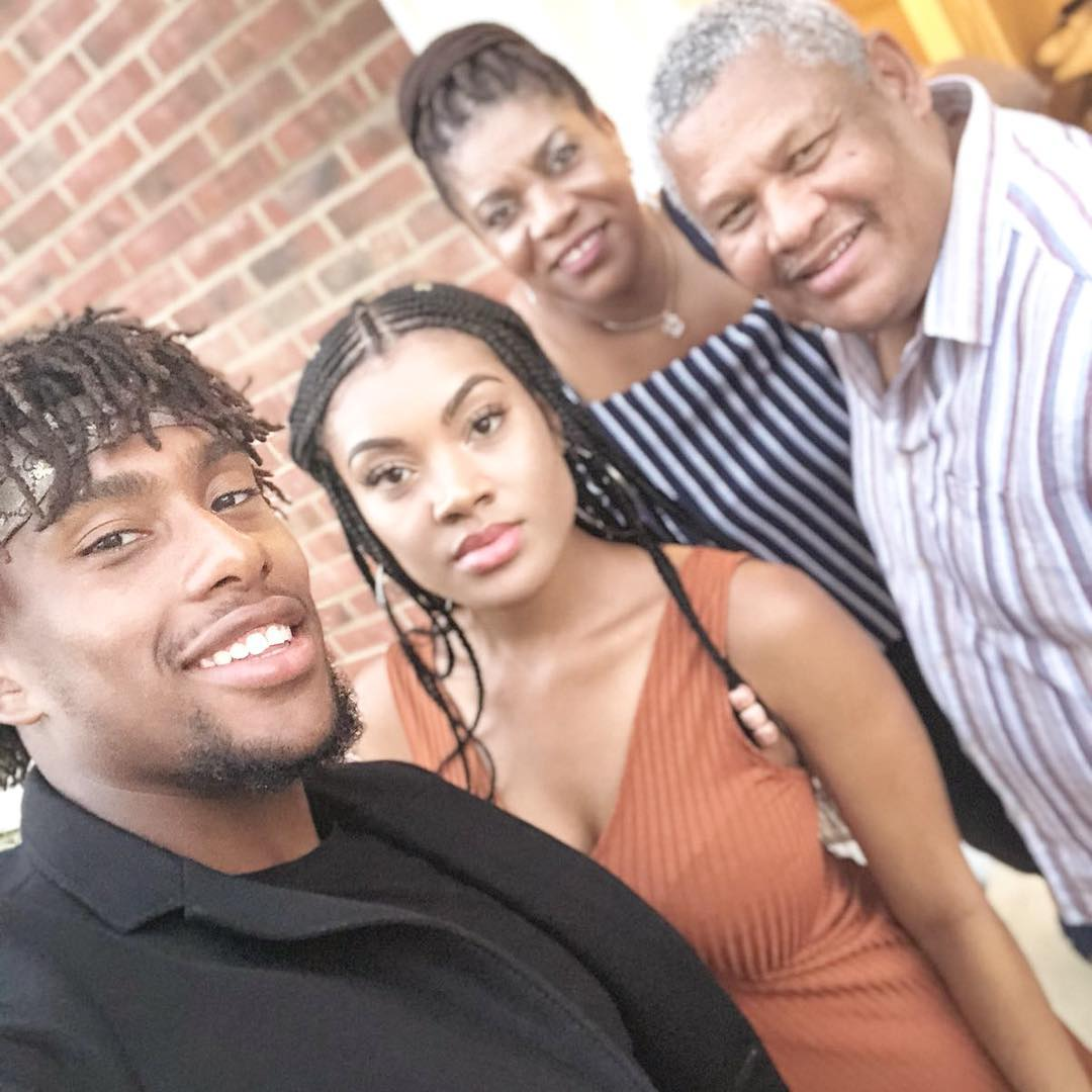 Alex Iwobi Poses With His Parents And Sister