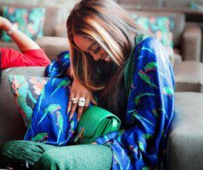 Tiwa Savage Playfully Attempts To Slap Wizkid Over Teni